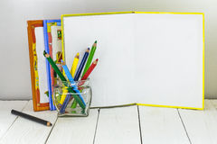 Childrens creativity, pencils, scissors, colored paper Stock Photo