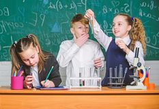 Childrens day. Chemistry. Back to school. Little kids learning chemistry in school lab. Little children at school lesson stock images