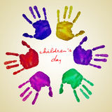 Childrens day. Handprints of different colors forming a circle and the text childrens day written in the center on a beige background stock illustration