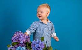Childrens day. Small baby boy. Summer. Mothers or womens day. New life concept. Spring holiday. Little boy at blooming royalty free stock photography