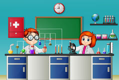 Childrens doing experiment in the lab Stock Photo