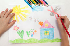 Childrens drawing. Child draws a pencil drawing of the world Royalty Free Stock Photos