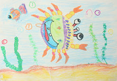 Childrens drawings. Crab and  fish Royalty Free Stock Images