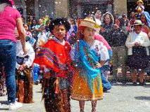 Childrens dressed in typical costumes of Ecuador dancing at the parade. royalty free stock images