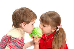Childrens eat cabbage on white Stock Images