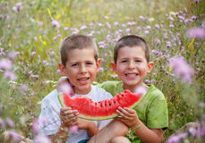 Childrens eating watermelon Royalty Free Stock Photo