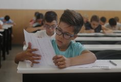 Childrens in an exam. During a mathematics test organized by the University of the Balearic Islands and the Baler Society of Mathematics in Mallorca, Balearic Stock Images