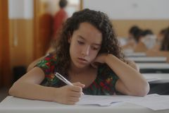 Childrens in an exam. During a mathematics test organized by the University of the Balearic Islands and the Baler Society of Mathematics in Mallorca, Balearic Stock Image