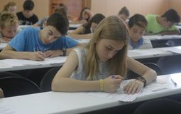 Childrens in an exam. During a mathematics test organized by the University of the Balearic Islands and the Baler Society of Mathematics in Mallorca, Balearic Royalty Free Stock Images