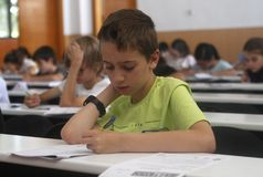 Childrens in an exam. During a mathematics test organized by the University of the Balearic Islands and the Baler Society of Mathematics in Mallorca, Balearic Royalty Free Stock Image