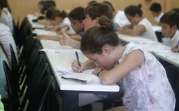 Childrens in an exam. During a mathematics test organized by the University of the Balearic Islands and the Baler Society of Mathematics in Mallorca, Balearic Stock Photo