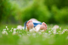 Childrens feet on grass in summer park Royalty Free Stock Photography