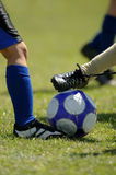 Childrens Football - Soccer. Several set of feet trying to control soccer ball - football royalty free stock photos