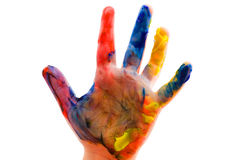 Childrens hand in the paint close up Stock Image