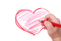 Childrens hand with pencil draws the heart royalty free stock photos