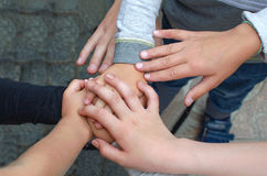 Childrens hands in a circle. A hands a group of children Stock Photo