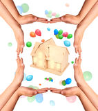 Childrens hands gesture and house model Royalty Free Stock Images