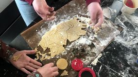 Childrens` hands making unicorn shaped christmas cookies. With metal cutter. Close-up stock video footage