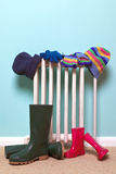 Childrens hats, gloves and wellies by radiator Royalty Free Stock Photo