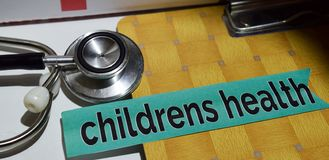 Childrens health on the print paper with medical and Healthcare Concept stock photography