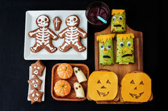 Childrens with lunch in the form of monsters Stock Images