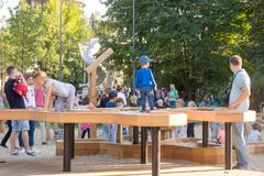 Childrens on the new childrens playground, Gorky Park. Moscow. Moscow, Russia - September 15, 2018: Childrens on the modern childrens playground in the Gorky royalty free stock photo