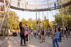 Childrens on the new childrens playground, Gorky Park. Moscow. Moscow, Russia - September 15, 2018: Childrens on the modern childrens playground in the Gorky royalty free stock image
