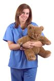 Childrens Nurse. Young Happy Childrens Nurse With Teddy Bear Isolated Royalty Free Stock Images