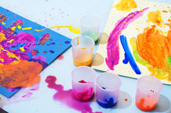 Childrens painting. Childs painting and artwork on coloured paper Stock Photography