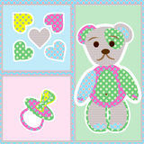 Childrens panel on a white substrate. With a bear cub from rags, hearts and a babys dummy Stock Photos