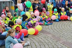 Childrens parade as part of the Jazz Festival Sildajazz in Haugesund, Norway. HAUGESUND, NORWAY – AUGUST 7, 2015: Children are listening to a swing band. On Stock Photos