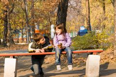 Childrens in the park. Two childrens in the autumn's park Stock Photos