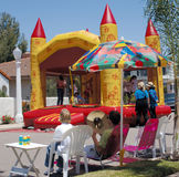 Childrens Party. An inflatable bouncy castle in a neighborhood Royalty Free Stock Photography