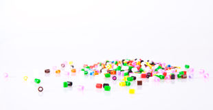 Childrens play pearls. Scattered on white background Stock Image