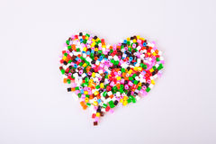 Childrens play pearls. Shaped as a heart Stock Photo