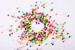 Childrens play pearls. Shaped as a heart royalty free stock photos