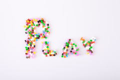 Childrens play pearls. Spelling out the word play Stock Photo