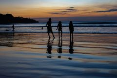 Childrens play on sunset Indian ocean stock photography
