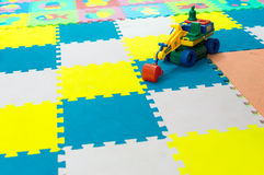 Childrens Play Toy on Bright Soft Tiles Royalty Free Stock Photos