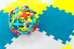 Childrens Play Toy on Bright Soft Tiles Stock Photos