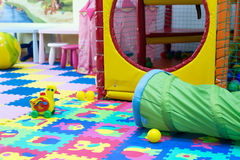 Childrens Play Toys on Bright Soft Tiles Stock Photo
