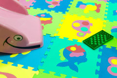 Childrens Play Toys on Bright Soft Tiles Stock Image