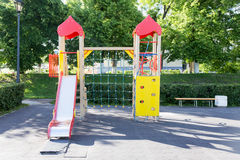 Childrens playground area in city park. Modern Playground Equipment. Modern Colorful kids playground on yard in the park. image for background of playground stock photo