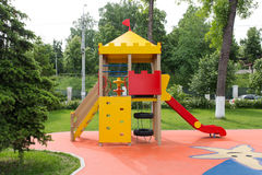 Childrens playground area in city park. Modern Playground Equipment. Modern Colorful kids playground on yard in the park. image for background of playground stock photos