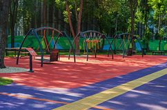 Childrens inclusive park. Childrens playground with swings in citys inclusive park in the middle of summer royalty free stock images