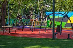 Childrens inclusive park. Childrens playground with swings and places for rest in citys inclusive park in the middle of summer royalty free stock photos