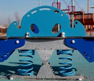 Childrens playground toy. Childrens blue playground toy in the park Stock Image