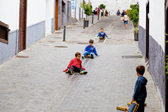 Childrens playing with wooden planks Stock Image