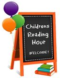 Childrens Reading Hour, Chalkboard Easel Sign, Books, Balloons Royalty Free Stock Photos