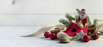 Childrens red shoe filled with sweets and christmas decoration f Royalty Free Stock Image